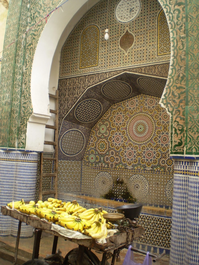 A timeless scene in Morocco - Fountain and fresh fruit